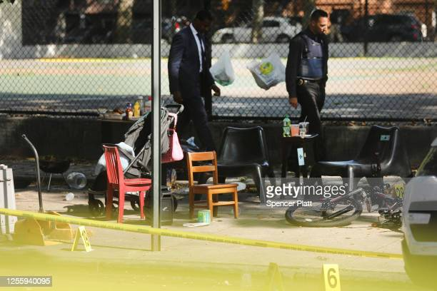 Police ballistic markers stand besides a child's chair and bicycle at a crime scene in Brooklyn where a one year old child was shot and killed on...