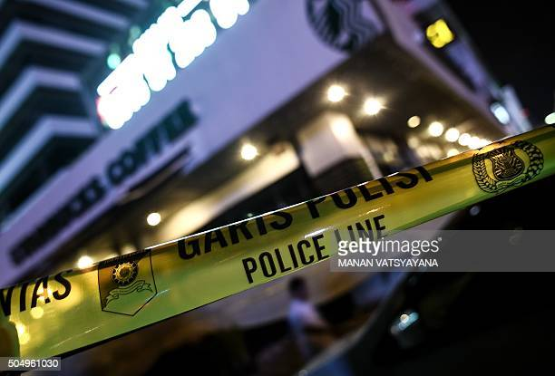 A police banner is seen outside a damaged Starbucks coffee shop after a series of explosions hit central Jakarta on January 14 2016 A 'Parisstyle'...
