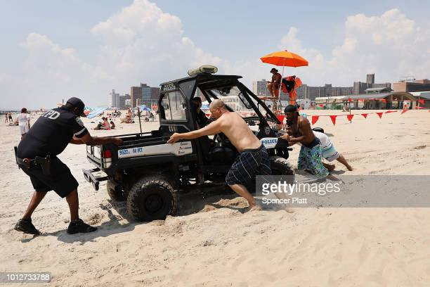 A police beach vehicle becomes stuck in the sand at Coney Island on a hot summer afternoon on August 7 2018 in the Brooklyn borough of New York City...