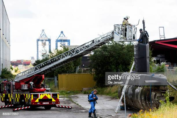 Police begin their forensic investigation work on the privately owned submarine Nautilus which is the suspected crime scene for the assumed murder on...