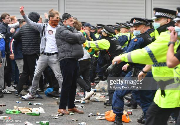 Police begin to clear the concourse after Manchester United fans had protested about the owners of the club before the Premier League match between...