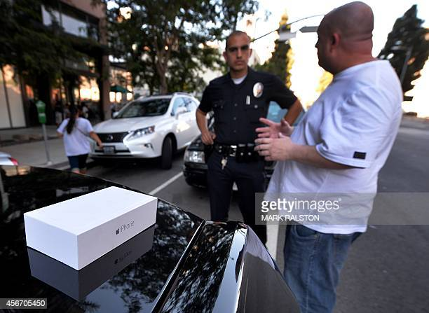 Police beside a recovered boxed IPhone 6 Plus in a theft and assault case where a man answering an online advertisement pretended to be a buyer for...
