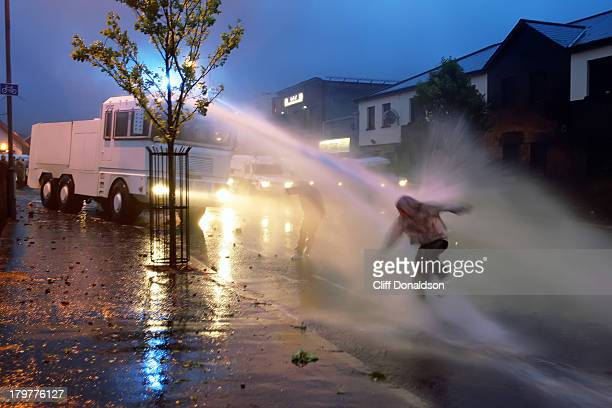 CONTENT] Police blast a stonethrower with a jet of water during this week's riots in the Ardoyne area of Belfast Picture Cliff Donaldson