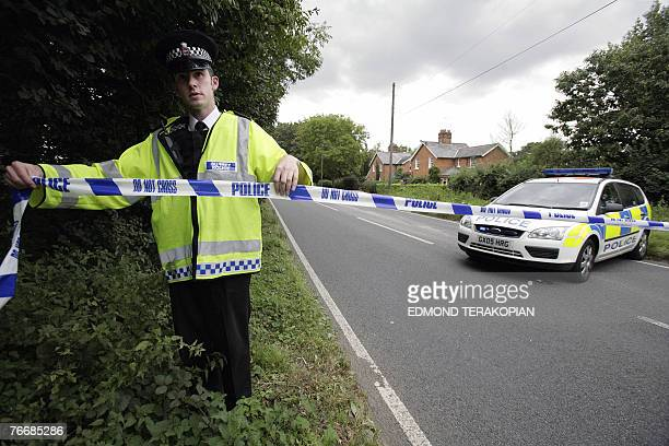Police block a road due to an outbrake of foot and mouth disease in Chertsey Surrey 12 September 2007 Britain's chief vet confirmed a new case of...