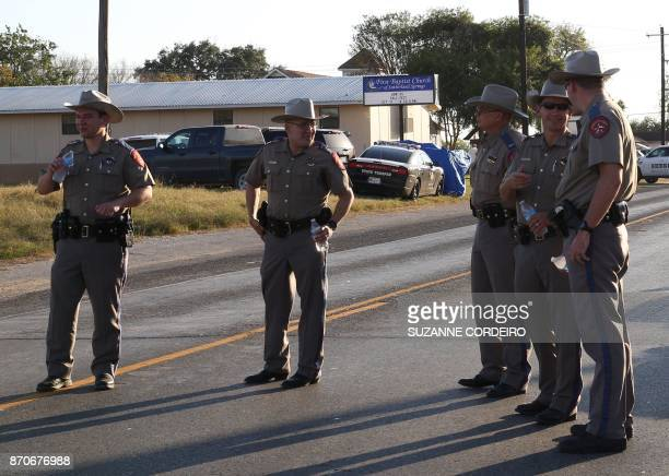 Police block a road in Sutherland Springs Texas on November 5 after a mass shooting at the the First Baptist Church 'There are 26 lives that have...