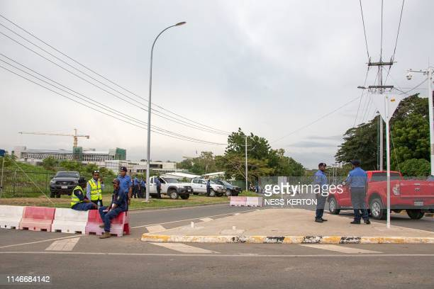 Police block a road leading to Parliament house in Port Moresby on May 28 2019 Papua New Guinea Prime Minister Peter O'Neill stalled his announced...