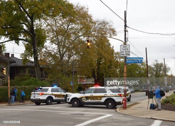 Police block a road near the Tree of Life Synagogue after a gunman opened fire inside at Squirrel Hill Pennsylvania on October 27 2018 A synagogue...