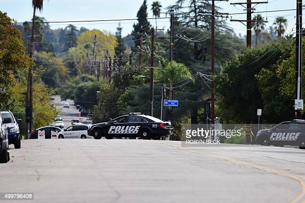 Police block a street on which FBI agents are investigating a townhome and a car in Redlands California December 3 2015 linked to the December 2...