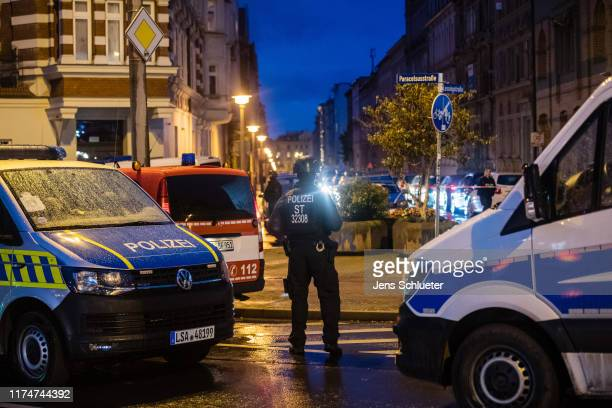 Police block access to a street near the scene of a shooting that has left two people dead on October 9 2019 in Halle Germany Law enforcement...