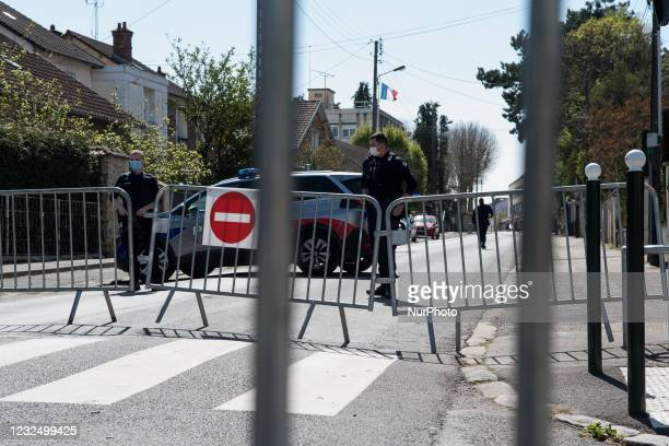 Police block access to the police station in Rambouillet, southwest of Paris, where a law enforcement administrative officer was killed in an attack....