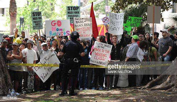 Police block an angry crowd of counterprotesters after the neonazi group The American National Socialist Movement held a rally in front of the Los...