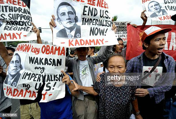 Police block antiUS activists protest outside the US embassy in Manila on January 15 accusing the US of imperialism and calling for a change in...