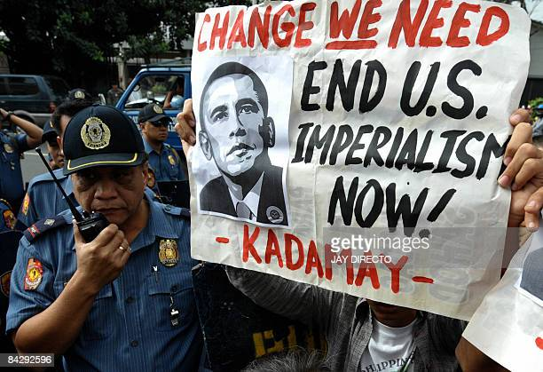 Police block antiUS activists protest protesting outside the US embassy in Manila on January 15 accusing the US of imperialism and calling for a...