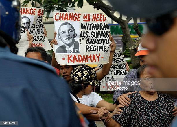 Police block antiUS activists protesting outside the US embassy in Manila on January 15 accusing the US of imperialism and calling for a change in...