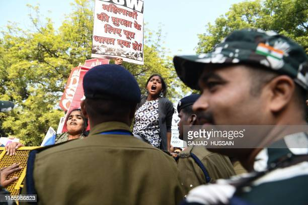 Police block demonstrators as they march to protest against the alleged rape and murder of a 27yearold veterinary doctor in Hyderabad in New Delhi on...