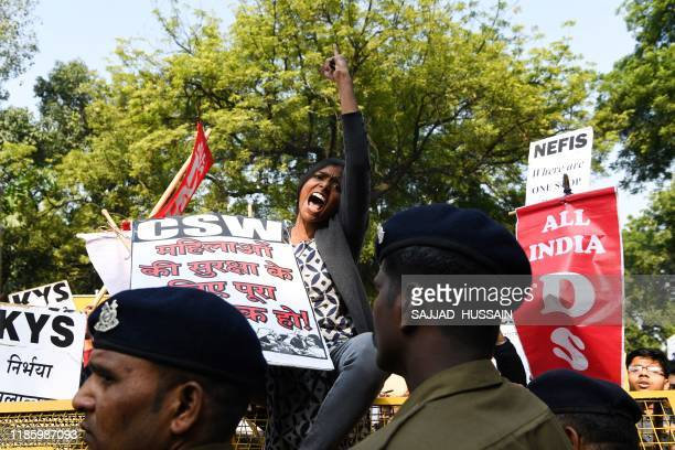 TOPSHOT Police block demonstrators as they march to protest against the alleged rape and murder of a 27yearold veterinary doctor in Hyderabad in New...