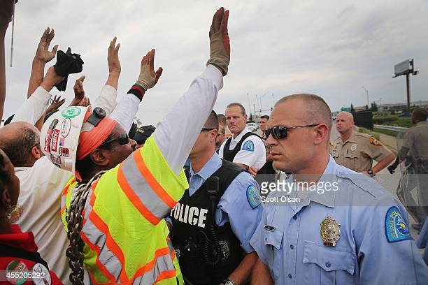 Police block demonstrators from gaining access to Interstate Highway 70 on September 10 2014 near Ferguson Missouri The demonstrators had planned to...