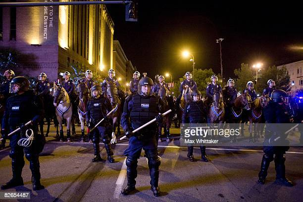 Police block off a street as Rage Against the Machine fans protest outside the Target Center on September 3 2008 in Minneapolis Minnesota The...
