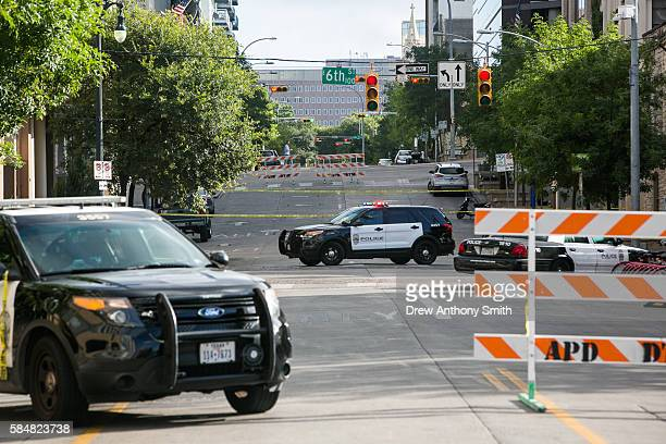 Police block off an area of 6th Street after two shootings July 31 2016 in downtown Austin Texas Austin Police say shots rang out in the city's...