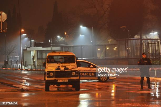Police block off the area around the US Embassy in Montenegro's capital Podgorica on February 22 2018 An unknown attacker blew themself up after...
