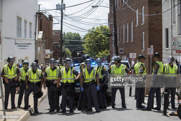Police block off the street after a car rammed into a crowd of antiWhite Supremacy protestors in Charlottesville Va USA on August 12 2017