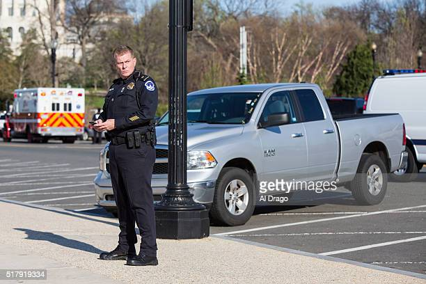 STATES MARCH 28 Police block off the surrounding area around a pickup truck that is believed to be in connection with the shooting that occurred...