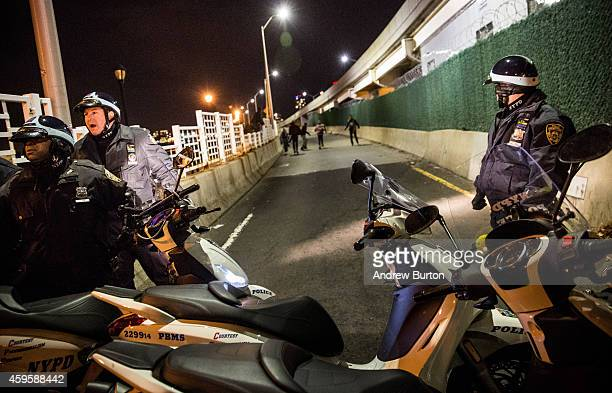 Police block people from marching onto FDR drive while protesting the Ferguson grand jury decision to not indict officer Darren Wilson in the Michael...