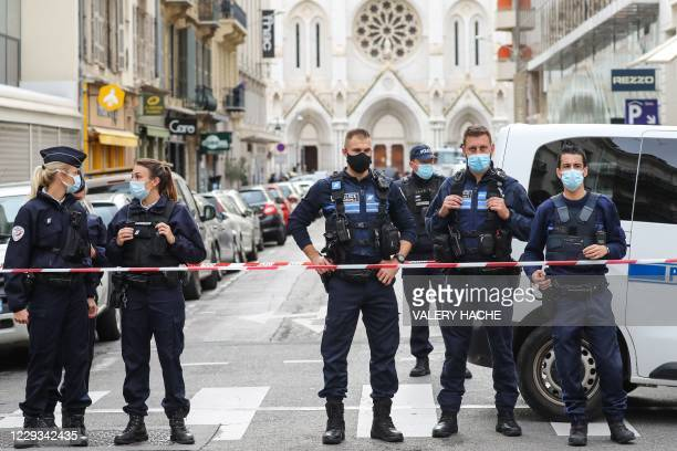 Police block the access to the Notre-Dame de l'Assomption Basilica in Nice on October 29, 2020 after a knife-wielding man kills three people at the...