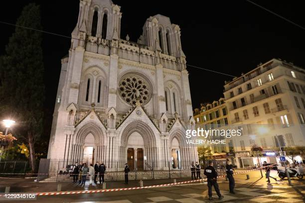 Police block the access to the Notre-Dame de l'Assomption Basilica in Nice on October 29, 2020 after a knife-wielding man kills three people in the...