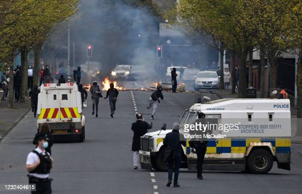 Police block the road after loyalists start fires and throw projectiles on Lanark Way near the 'Peace Gates' interface on April 19, 2021 in Belfast,...
