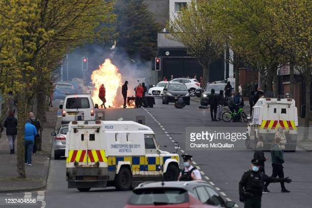Police block the road after loyalists start fires on Lanark Way near the 'Peace Gates' interface on April 19, 2021 in Belfast, Northern Ireland....