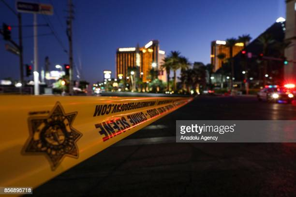 Police block the roads leading to the Mandalay Hotel and inspect the site after a gunman attack in Las Vegas NV United States on October 02 2017 At...