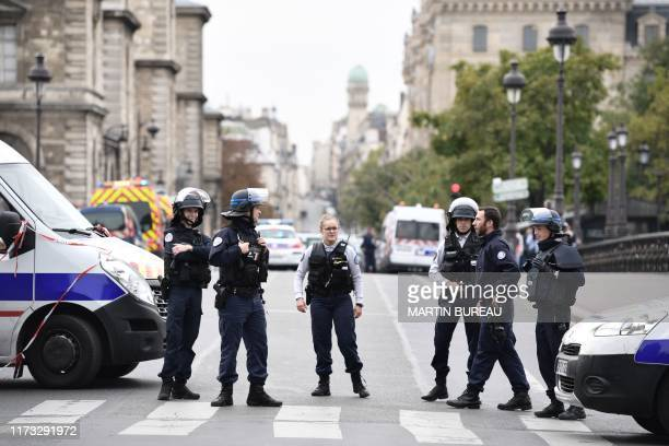 Police block the street after three persons have been hurt in a knife attack at Paris prefecture de police on October 3 2019 A knife attacker was...