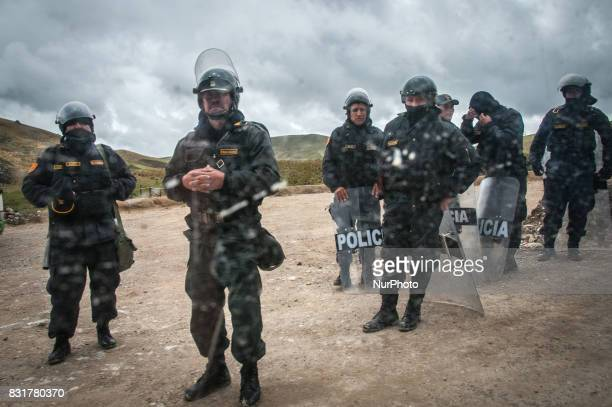 Police blocking a mountain road during a protest against the proposed Conga gold mine in Cajamarca Peru Photo taken March 22 2017Cajamarca Peru is...