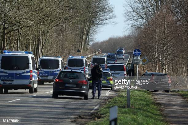 Police blocks a road near the site where a 80yearold was attacked with a knife on March 10 2017 in Duesseldorf western Germany The attack took place...