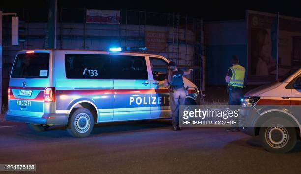 Police blocks a street near the site of a shooting in Gerasdorf, near Vienna, on July 4, 2020. - Austrian police have arrested a Russian from...