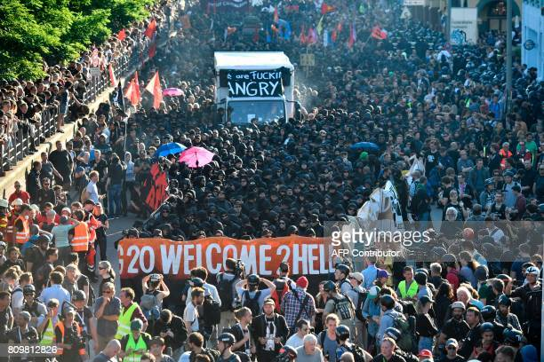 Police blocks demonstrators during the 'Welcome to Hell' rally against the G20 summit in Hamburg northern Germany on July 6 2017 Leaders of the...