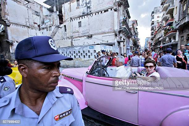 Police blocks the access as Cubans wait to get a glimpse of the invitees motorcade of the fashion show by Chanel unveiling German designer Karl...