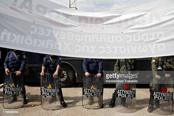 Police blocks the entrance to the Police Headquarters department of Thessaloniki during a protest against the arrest of two residents of Ierissos...