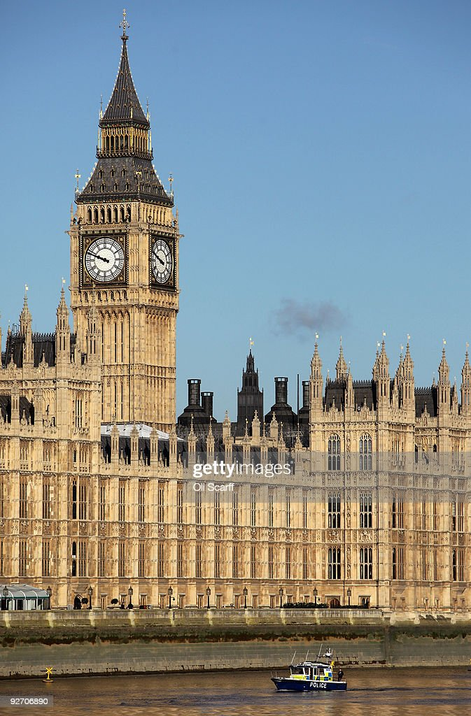 A police boat passes in front of the Houses of Parliament on November 3, 2009 in London, England. A review into MP's expenses published today by Sir Christopher Kelly has recommended that MP's mortgage claims should be replaced by rental claims and the employment of relatives should be phased out within five years.