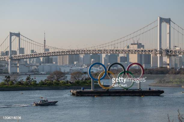 Police boat passes the Tokyo 2020 Olympic Rings on March 25, 2020 in Tokyo, Japan. Following yesterdays announcement that the Tokyo 2020 Olympics...