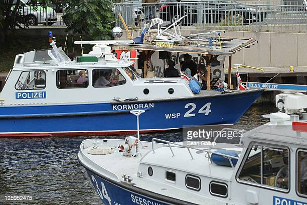 Police boats intercept antiPope protesters on the Spree river near the Reichstag shortly after the arrival of Pope Benedict XVI on September 22 2011...