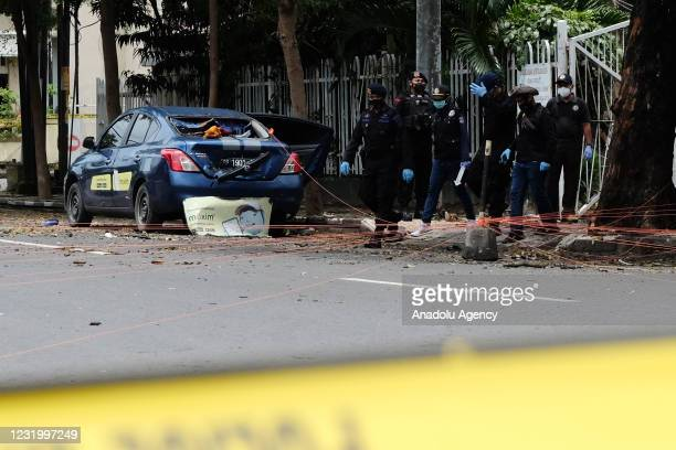 Police bomb squad and laboratory and forensics team work at the crime scene of the suicide bombing in front of the Makassar Cathedral Church, on...