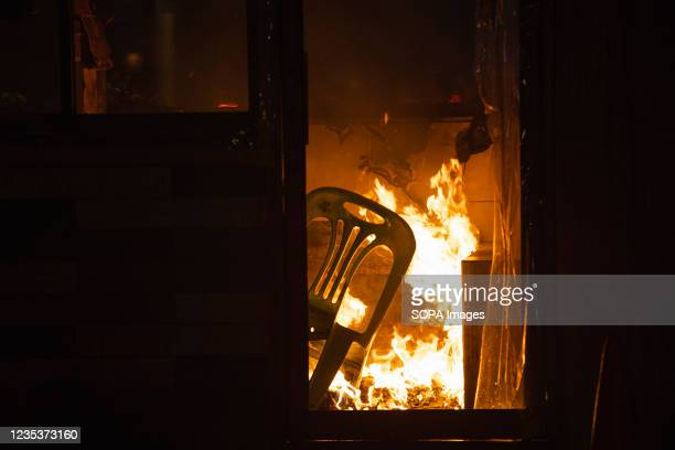 Police booth near the government house seen burning during the demonstration. The pro-democracy protesters gathered at democracy monument before they...