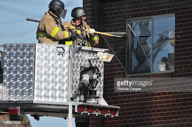 Police break the window of the apartment of of James Holmes the suspect of a shooting in a movie theater July 20 2012 in Aurora outside of Denver...