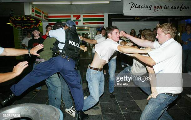 Police break up a fight breaks that broke out on the first weekend of Schoolies at Surfers Paradise on the Gold Coast 19 November 2005 THE AGE NEWS...
