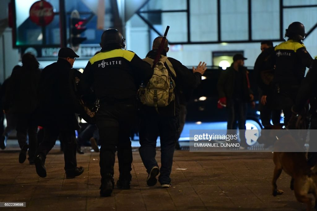 Police break up protests that erupted after Dutch authorities barred Turkish ministers from visiting, early March 12, 2017 in Rotterdam. After initially dispersing, the crowd began to gather in smaller groups again, with the police once again moving in, an AFP correspondent said. The move came as the city's authorities expelled Turkey's Family Minister Fatma Betul Sayan Kaya and escorted her back to the German border. PHOTO / Emmanuel DUNAND