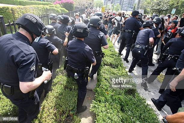 Police break up rockthrowing antineoNazi demonstrators after a National Socialist Movement rally near City Hall on April 17 2010 in Los Angeles...