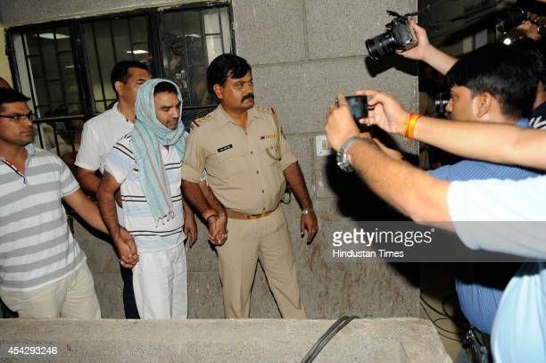 Police brought Chandra Mohan Sharma to Noida from Bangalore on August 28 2014 in Noida India Chandra Mohan Sharma who was thought to be found 'burnt...