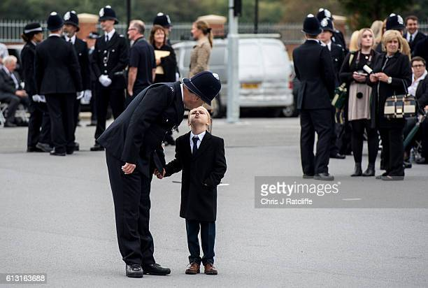 Police cadet David Thompson gets a kiss from his son David before the start of the Metropolitan Police 'Passing Out Parade' outside Peel House at...